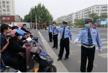信阳公安交警切实做好复工复产后的道路交通秩序维持工作