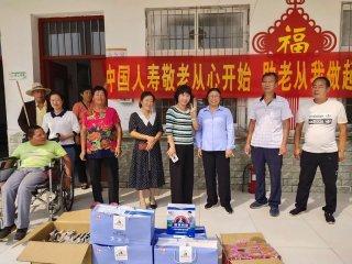 中国人寿汝南分公司慰问金铺镇重残托养中心残疾人