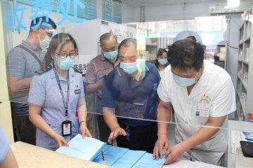 郑州市二七区市场监督管理局召开基层诊所标准化药房建设观摩会